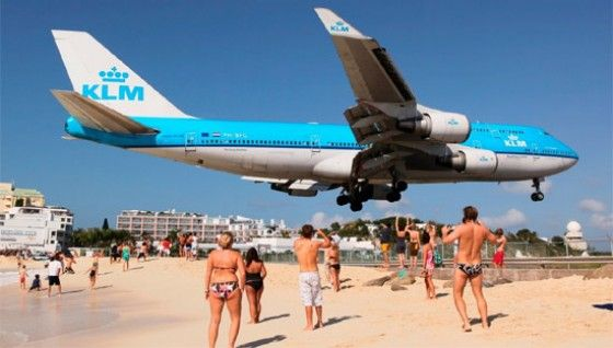 plane lands on vacation beach