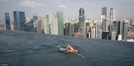 A Creep Bald Man Swimming In The Marina Bay Sands Infinity Pool