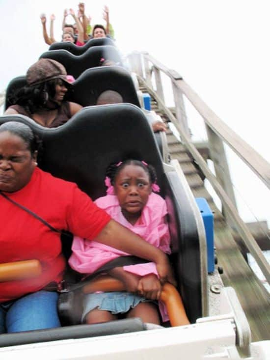 Scared Black girl on Roller Coaster