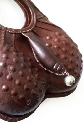 A Handbag With Leather Penis And Bell