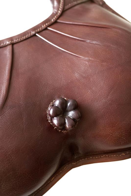 A Handbag With Leather Anus