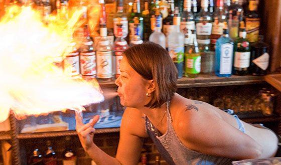 Woman Spraying Fire At A Bar