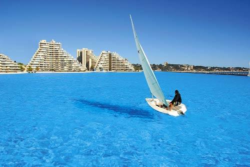A Woman Sailing On San Alfonso Del Mar