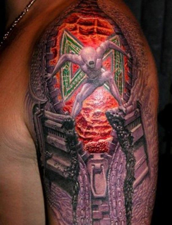 Crazy alien tattoo on the arm