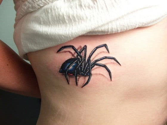 Nasty big spider tattoo on a persons back