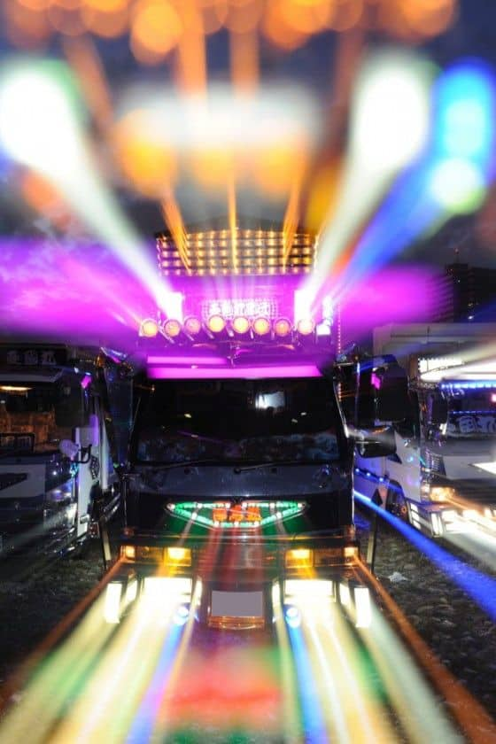 Brightly lit Japanese Trucks with crazy decorations