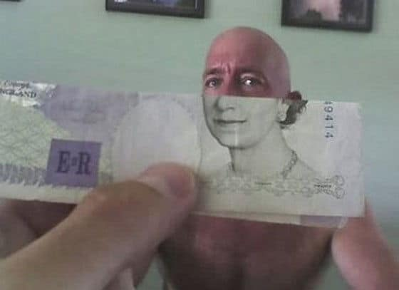 Face behind a dollar bill blending into the money