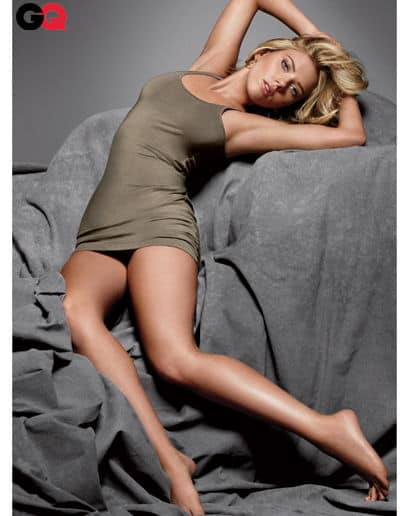 Scarlett Johansson wearing olive drab laying down on grey on the GQ magazine cover