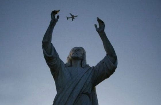 Statue of Jesus grabbing an airplane