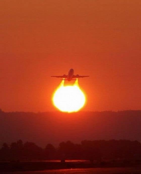 Perfectly timed photo of jet flying into the sun set