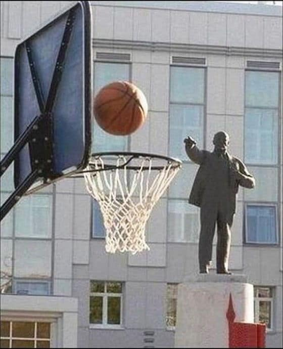 Statue shoots and scores at a basketball net