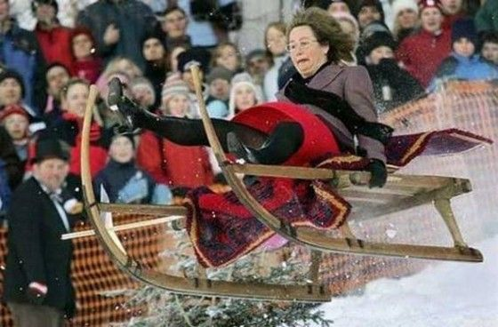 Flying sled through the air with a woman on it