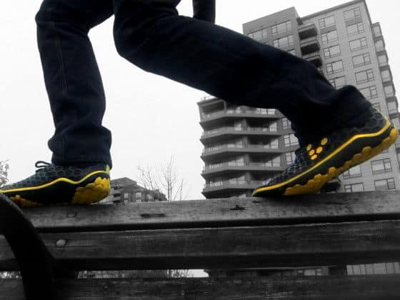 Balancing on a wooden bench wearing Terra Plana Evo IIs