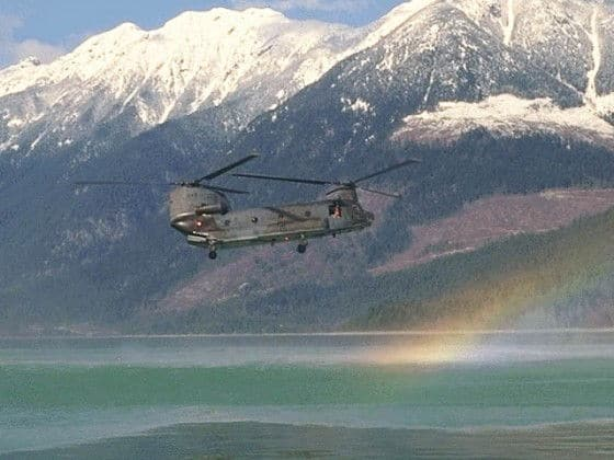 Chinook helicopter flying over a rainbow