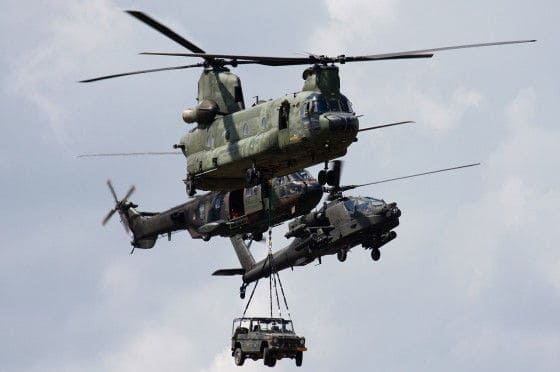 CH-47 Chinook transporting vehicles