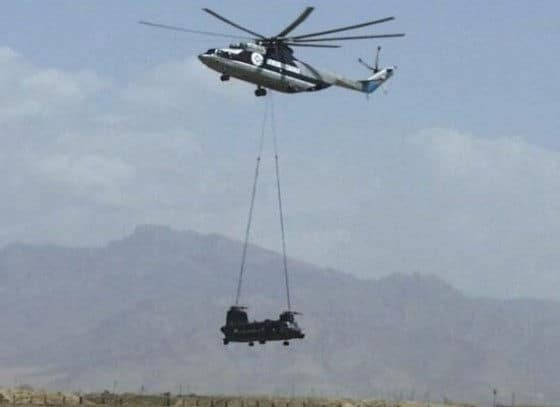 Russian MI-26 easily lifts Chinook helicopter