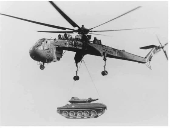 Ch-54 Tarhe helicopter lifting a heavy battle tank