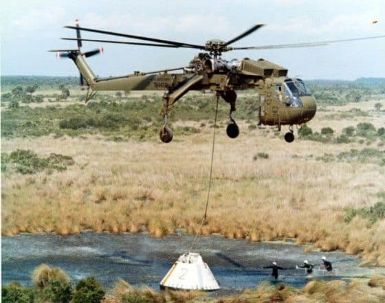 CH54 helicopter picking up object out of a lake