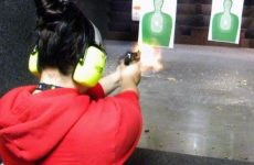 Girl Firing A Pistol With Muzzle Flash