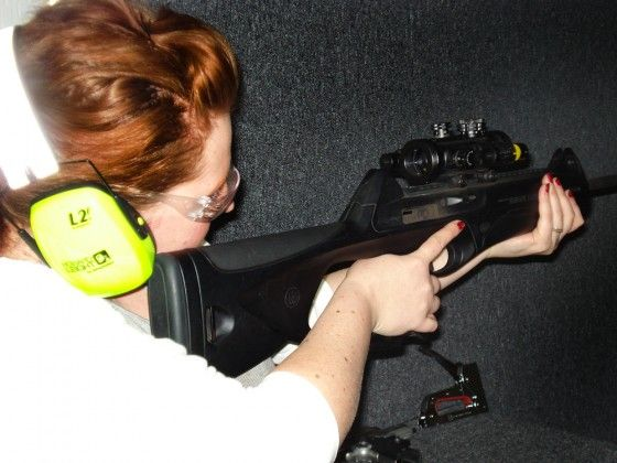 Gina Firing A 22LR Rifle