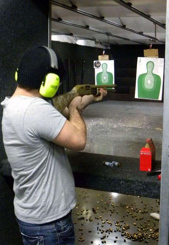 A Man Firing A Shotgun With Birdshot