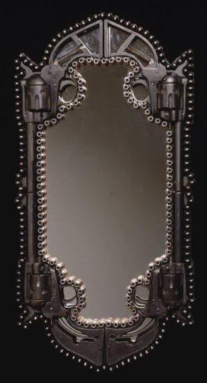 tall mirror made from guns and bullets by al farrow