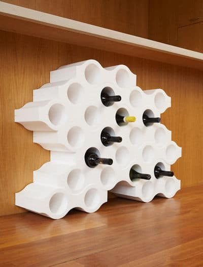 a wine bottle honeycomb holder