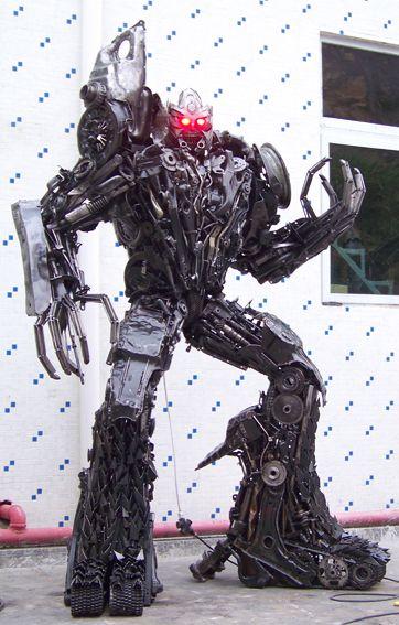 giant megatron robot built out of iron scraps