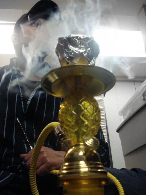 Exhaling Hookah smoke slowly