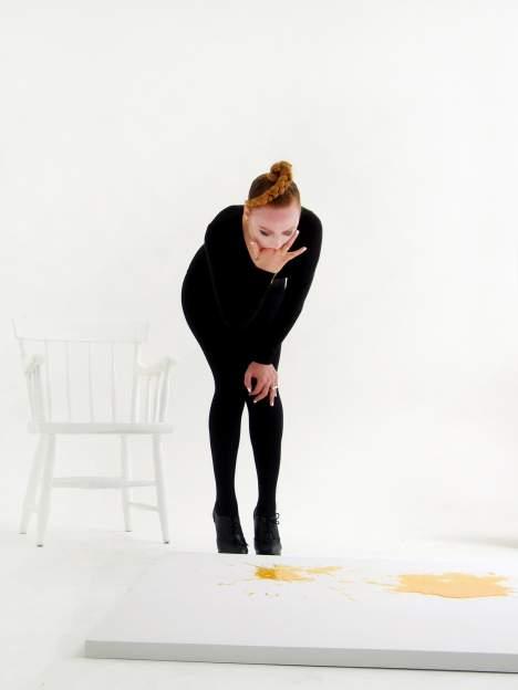 Millie Brown puking rainbows onto canvas