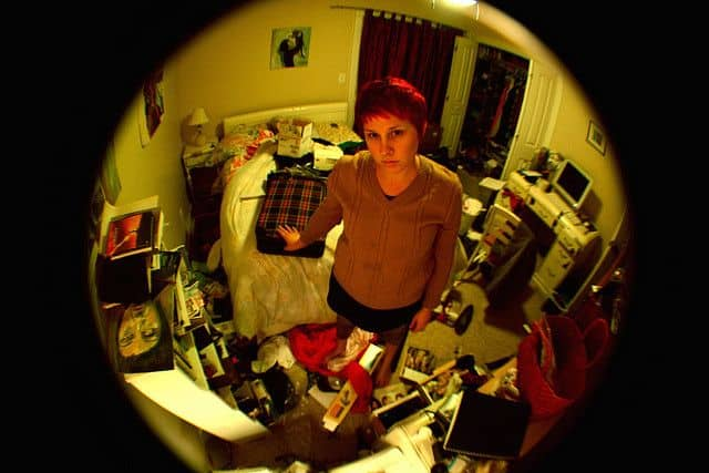 a woman in a very messy room