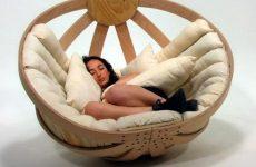 Woman sleeping in a cradle