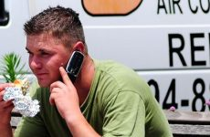 A man planning his weekend over the phone
