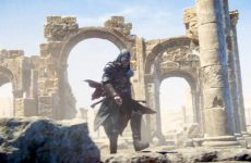Ezio wanders through ruins in the desert assassin's creed revelations