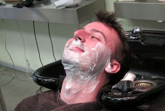 Chad smiling while getting a straight razor shave