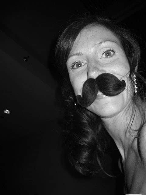 black and white photo of girl with moustache