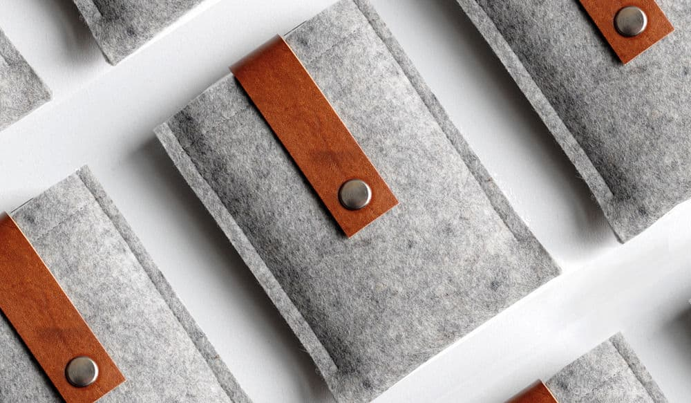 grey and brown wool and leather device cases by Byrd & Belle