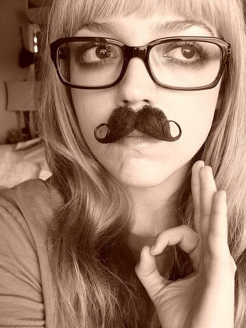 girl with big glasses and moustache