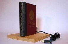 hardcover book on secret passage lamp