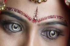 Woman wears contact lenses with diamonds in them