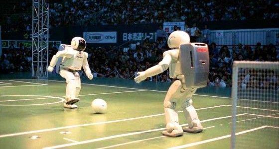 Honda ASIMO robots play soccer