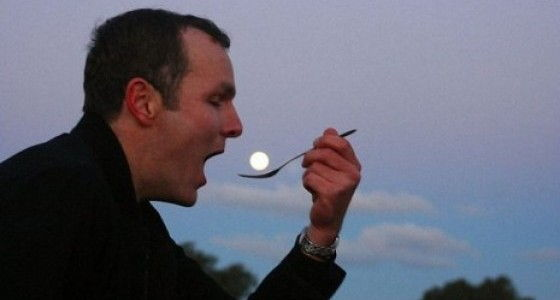 Perfectly Timed Photos man eating moon
