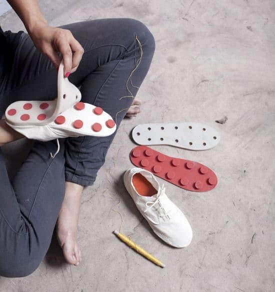 man repairing his shoe