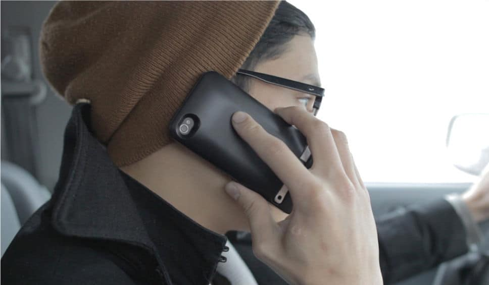 JuiceTank iPhone charger case in use