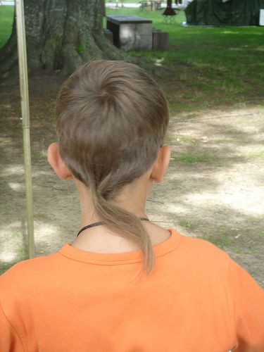 Boy with rat tail haircut