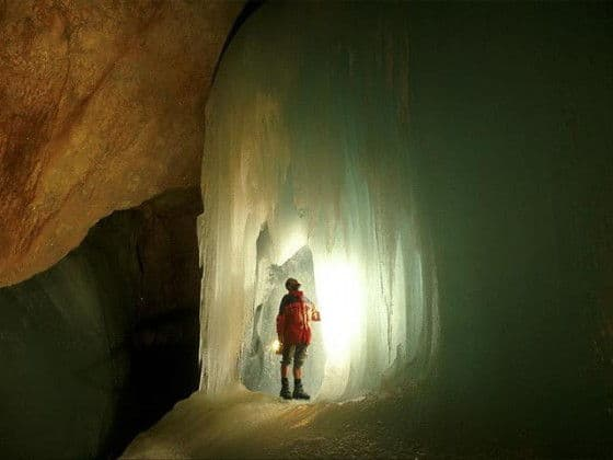 man in ice cave