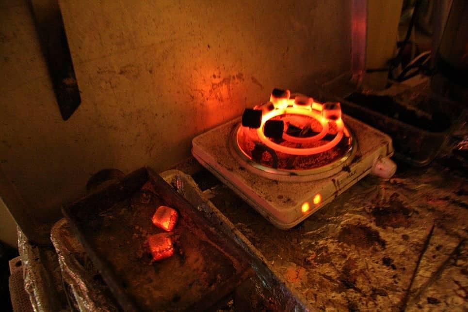 Charcoal being heated up for Hookah Shisha