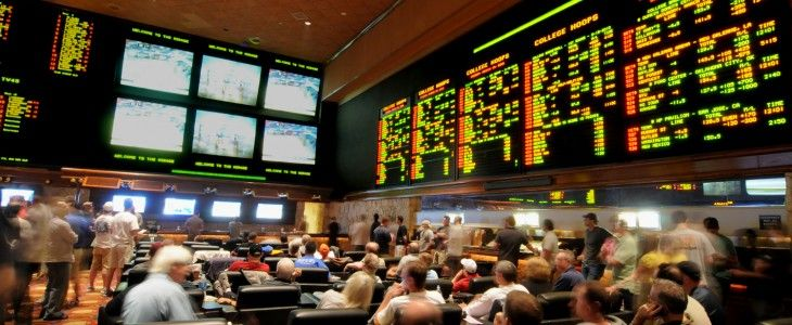 people gathered for sports betting