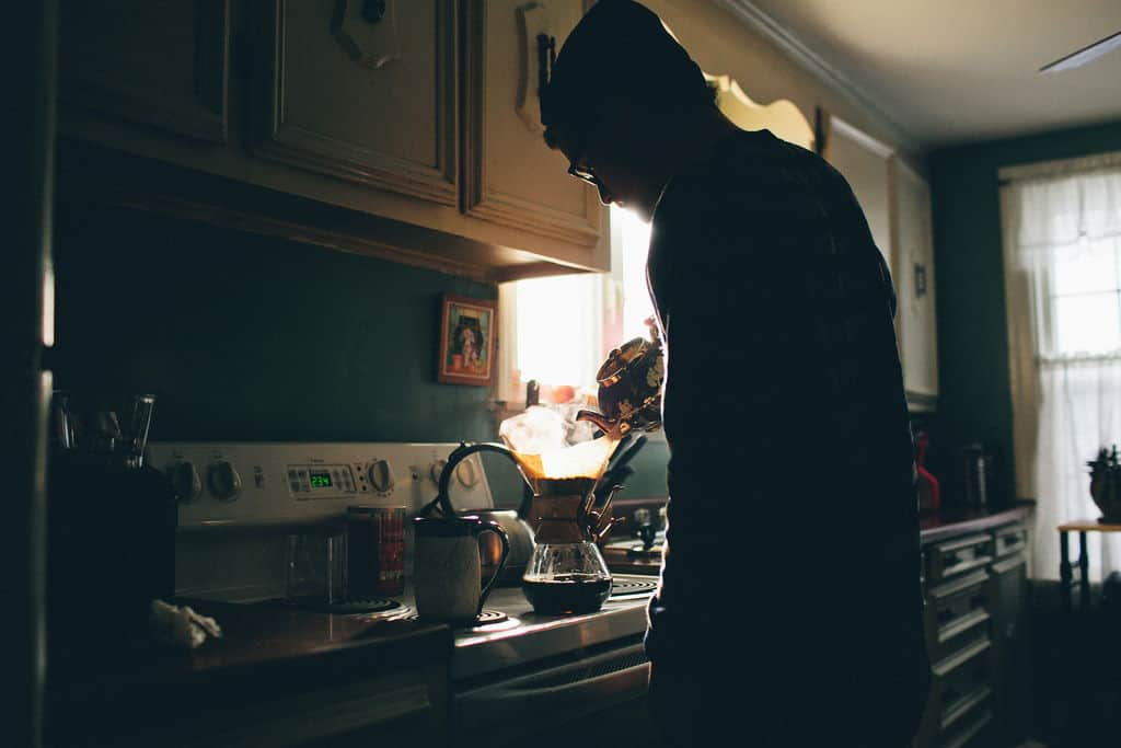 man brewing coffee