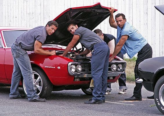 greasers under car hood